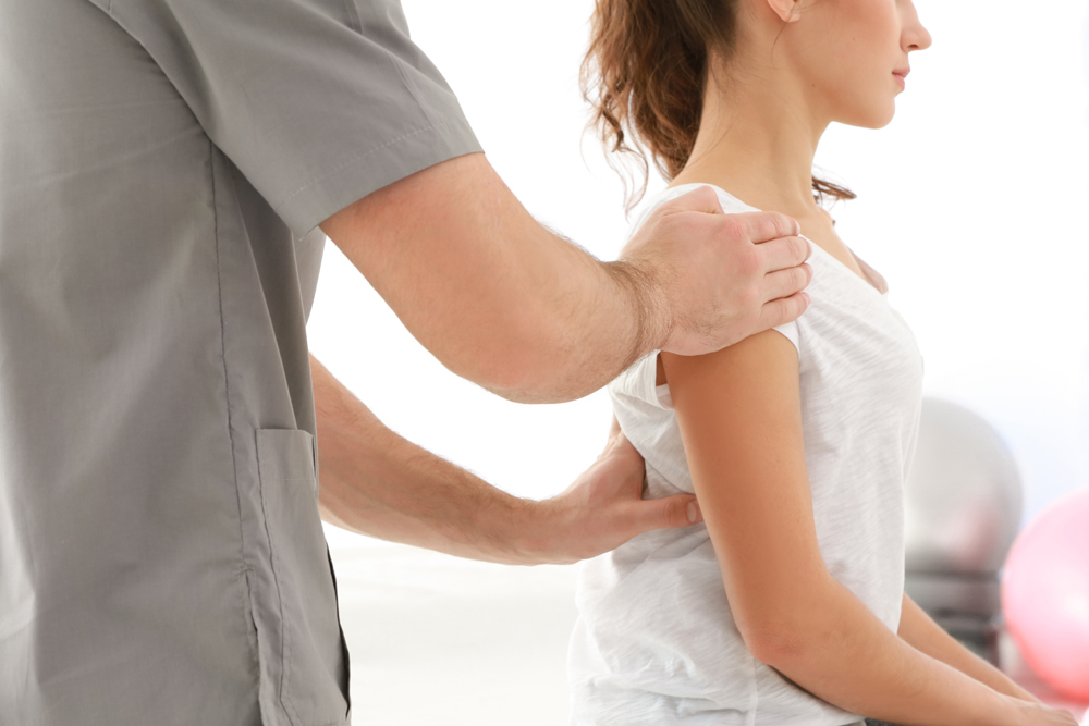 Chiropractor treating patient with back pain